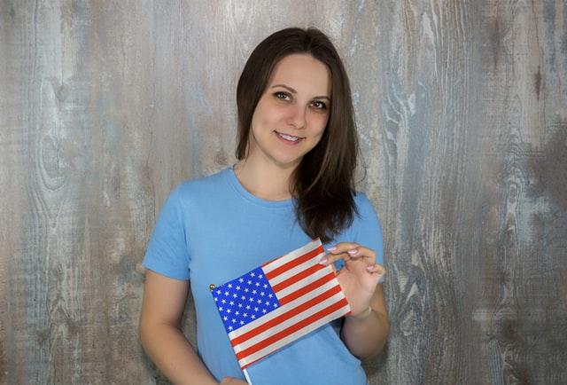 girl holding usa flag